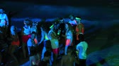 ada : KOH PHANGAN, THAILAND - FEBRUARY 01, 2018: Girls and guys participate in the Full Moon party in island Koh Phangan, Thailand. Event now attracts anywhere about 30,000 party-goers on a normal month