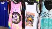ada : KOH PHANGAN, THAILAND - MARCH 01, 2018: Colorful t-shirts are put up for sale on the beach before the Full Moon Party on the island of Koh Phangan, Thailand