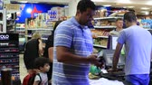 fizet : SHARM EL-SHEIKH, EGYPT - MAY 22, 2018: People come in and pay for goods at the checkout in the supermarket in Sharm El Sheikh, South Sinai, Egypt Stock mozgókép