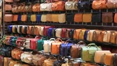 toka : SHARM EL-SHEIKH, EGYPT - MAY 20, 2018: Varied choice of bags in the store sells for tourists in the Naama Bay area in Sharm El Sheikh, South Sinai, Egypt. The Asian market in the Arabian Egypt Stok Video
