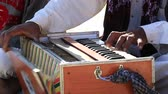 tribo : Close up shot of traditional musical instruments harmonium playing in Jaisalmer fort, Rajasthan, India