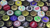 alkoholos : Moscow, Russia - April 22, 2018: Background of beer bottle caps, a mix of various global brands: Grolsch, Bud, Bavaria, Miller, Heineken Baltika corona extra etc