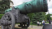 car : Moscow, Russia-may 23, 2018: Tsar cannon (Tsar cannon) on Ivanovskaya square and view of the Senate building in the Moscow Kremlin. Walking tourists in the Kremlin