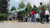 artilharia : Moscow, Russia-may 23, 2018: Tsar cannon (Tsar cannon) on Ivanovskaya square in the Moscow Kremlin. Walking tourists in the Kremlin