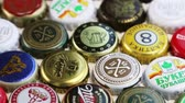 aluminium : Moscow, Russia-30, 2018: beer bottle caps background, mix of different world brands: grolsch, Bud, Bavaria, Miller, Heineken, Baltika; Corona Extra, etc. Dolly video Wideo