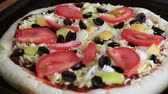 supremo : freshly baked pizza with salami, mushrooms and cheese. pizza and ingredients