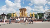 ussr : Moscow, Russia-August 09, 2018: tourists and residents of the city on a walk at the fountain Friendship of peoples at VDNH