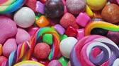 group of children : variety of sweets, lollipops, candy, marshmallows, etc. Rotation video Stock Footage