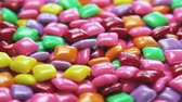 rágás : chewing gum of different colors. background of chewing gum. VIDEO rotation Stock mozgókép
