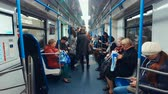 депо : Moscow, Russia-October 11, 2018: interior of the Moscow metro train Moscow. Passengers enter the car and sit on the seats
