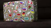 suitcase stickers of the flags of the countries from travels around the world. Dolly video