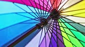 multi-colored umbrella rotates. umbrella made of different color of fabric strips Filmati Stock