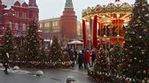 komor : MOSCOW, RUSSIA - January 13, 2018: townspeople and tourists walk by Manezhnaya square decorated for the holiday of new year and Christmas in Moscow. Russia.