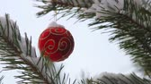 Christmas ball hanging on a festive Christmas tree. The scenery for the Christmas holiday and new year