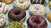 assorted donuts with different fillings and icing. Rotation video Filmati Stock