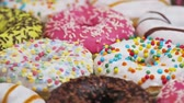 assorted donuts with different fillings and icing. Rotation video Stok Video