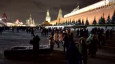 Moscow Kremlin and walking tourists and people on red square. motion timelapse