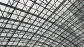 glass roof of a modern evening time building. The overlap of the roof of the building
