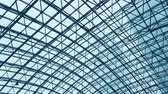 dakraam : glass roof of a modern evening time building. The overlap of the roof of the building