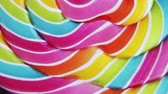 ロリポップ : Background of striped spiral multicolor Lollipop close up