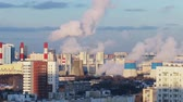 nukleáris : Smoking chimneys of a thermal power plant in the big city Stock mozgókép