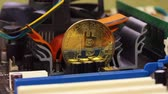 miner : Golden bitcoin stands on the scheme of a computer hardware