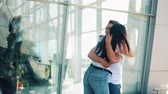 ecstatic : The long-awaited meeting at the airport loving couple. Love and hug each other. Meeting of two loving people. Slow motion
