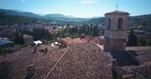 benátský : Tagliacozzo, AQ. Italy. Aerial view of old city center with old houses and town hall. Drone flies over the roofs Dostupné videozáznamy