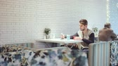 hipster : Young man with smartphone sitting in cafe, close-up