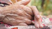 senior people : Grandmother making massage her wrinkled hands outside. Elderly woman taking care of her arms outdoor. Close up Side view Slow motion