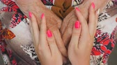 неузнаваемый : Young female arms with beautiful manicure comforting an elderly pair of old woman hands. Granddaughter and grandmother spending time together. Caring and loving concept. Close up Top view Slow motion