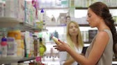 xampu : Beautiful girl pharmacist consulting a customer