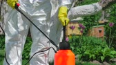 pesticide : Gardener using pump sprayer for fertilizing trees