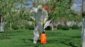 pesticide : Professional gardener prepares to spray trees