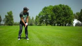 attentiveness : Young male playing golf at the golf field