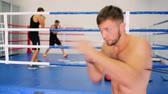 uppercut : Boxers work out in the air strikes. Stock Footage
