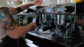 tumblers : The bartender preparing coffee with coffee machine