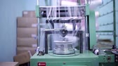 thread warping : Iron cylinder weaves the fabric threads. Stock Footage