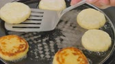 kaka : Close-up - cook turns cheese pancakes in a pan with a spatula
