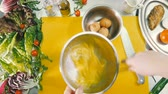 masse : The chefs hands beat three chicken eggs with a whisk in a bowl