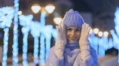 bokeh : Portrait of cute young woman at lights background