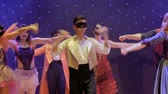 role : People in scenic costumes are dancing and singing on stage in modern theatre Dostupné videozáznamy