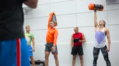 utolsó : Trainer shows a physical exercise for the young people in the gym