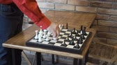 szachy : Mature man play chess with himself