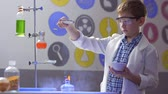reagent : Boy scientist makes experiments with starch and fire in laboratory