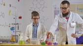 reagent : Laboratory assistant put dry ice into a colorful liquids