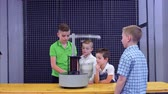 electromagnetic : Boys makes experiment with electromagnetic fountain and metal ring