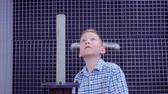 electromagnetic : Boy makes experiment with electromagnetic equipment in science museum