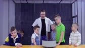 electromagnetic : Children and laboratory assistant makes physics experiment in science museum