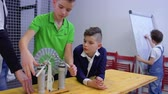 static electricity : Boys and teacher explores wimshurst machine